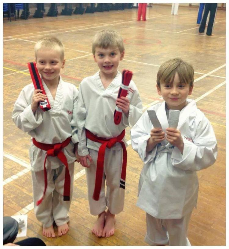 Little soldiers getting their belts